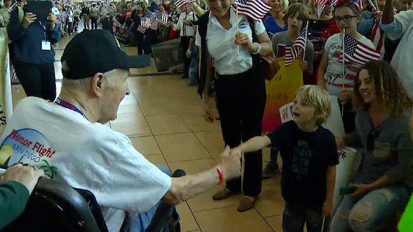 Honor Flight San Diego arrives to a heroes welcome